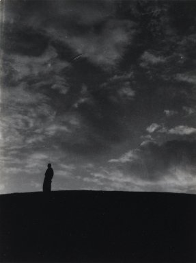 Consuelo Kanaga (American, 1894-1978). <em>[Untitled] (Man on Horizon, North Africa)</em>, 1928. Gelatin silver photograph, Image: 5 1/8 x 3 7/8 in. (13 x 9.8 cm). Brooklyn Museum, Gift of Wallace B. Putnam from the Estate of Consuelo Kanaga, 82.65.81 (Photo: Brooklyn Museum, 82.65.81_PS2.jpg)