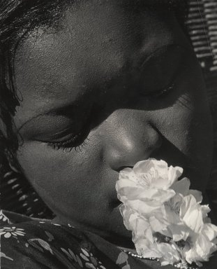 Consuelo Kanaga (American, 1894-1978). <em>[Untitled] (Portrait with Flower)</em>, early 1930s. Gelatin silver photograph, 9 7/8 x 8 in. (25.1 x 20.3 cm). Brooklyn Museum, Gift of Wallace B. Putnam from the Estate of Consuelo Kanaga, 82.65.90 (Photo: Brooklyn Museum, 82.65.90_PS2.jpg)