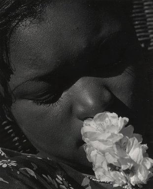 Consuelo Kanaga (American, 1894-1978). <em>[Untitled] (Portrait with Flower)</em>, early 1930s. Toned gelatin silver photograph, 9 7/8 x 8 in. (25.1 x 20.3 cm). Brooklyn Museum, Gift of Wallace B. Putnam from the Estate of Consuelo Kanaga, 82.65.91 (Photo: Brooklyn Museum, 82.65.91_PS2.jpg)