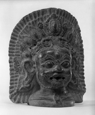 Unknown. <em>Head of Bhairava</em>, 17th century. Terracotta, 10 x 8 1/4 in. (25.4 x 21 cm). Brooklyn Museum, Gift of Ben B. Shepps, 82.77.1. Creative Commons-BY (Photo: Brooklyn Museum, 82.77.1_bw.jpg)