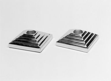 "Norman Bel Geddes (American, 1893-1958). <em>""Manhattan"" Candlestick, One of a Pair</em>, 1937. Chromed metal, 1 1/16 x 3/1/8 x 3 1/8 in. (2/7 x 8.0 x 8.0 cm). Brooklyn Museum, Gift of Paul F. Walter, 83.108.15. Creative Commons-BY (Photo: , 83.108.15_83.108.16_bw.jpg)"