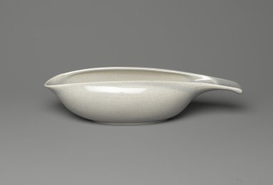 Russel Wright (American, 1904-1976). <em>Gravy Boat, Part of Two-Piece Set, American Modern Pattern</em>, Designed 1937; manufactured 1939-1959. Glazed ceramic, 2 1/2 x 2 1/2 x 10 3/8 in. (6.4 x 6.4 x 26.2 cm). Brooklyn Museum, Gift of Paul F. Walter, 83.108.32. Creative Commons-BY (Photo: Brooklyn Museum, 83.108.32_PS2.jpg)