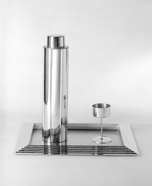 Norman Bel Geddes (American, 1893-1958). <em>Cocktail Glass, One of Eight</em>, 1937. Chrome-plated metal, 4 5/16 x 2 1/2 x 2 1/2 in. (11 x 6.4 x 6.4 cm). Brooklyn Museum, Gift of Paul F. Walter, 83.108.6. Creative Commons-BY (Photo: , 83.108.5-.14_view1_bw_SL3.jpg)