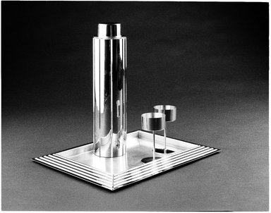 "Norman Bel Geddes (American, 1893-1958). <em>""Skyscraper"" Cocktail Shaker with Strainer and Lid</em>, Designed 1934. Manufactured 1935. Chrome-plated metal, 12 3/4 x 3 5/16 x 3 5/16 in. (32.4 x 8.4 x 8.4 cm). Brooklyn Museum, Gift of Paul F. Walter, 83.108.5a-c. Creative Commons-BY (Photo: Brooklyn Museum, 83.108.5a-c_SL3.jpg)"