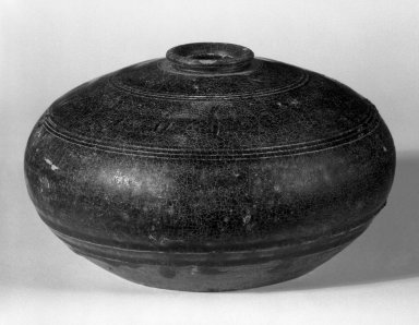 <em>Low Bottle</em>, 12th century. Buff stoneware, brown glazed, 3 x 3 3/4 in. (7.6 x 9.5 cm). Brooklyn Museum, Gift of Dr. Andrew Dahl, 83.112.7. Creative Commons-BY (Photo: Brooklyn Museum, 83.112.7_bw.jpg)