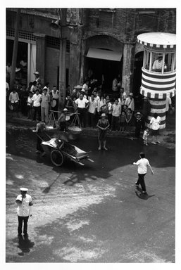 Eve Arnold (American, 1912-2012). <em>Wanhsien/Traffic Control</em>, 1979. Chromogenic photograph, image: 20 x 13 5/16 in. (50.8 x 33.8 cm). Brooklyn Museum, Gift of the artist in memory of Gene Baro, 83.128.6. © artist or artist's estate (Photo: Brooklyn Museum, 83.128.6_bw.jpg)