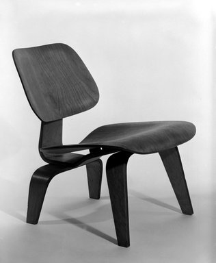 Charles Eames (American, 1907-1978). <em>Lounge Chair</em>, 1946. Ash plywood, rubber, metal, Overall: 25 3/8 x 22 x 23 in. (64.5 x 55.9 x 58.4 cm). Brooklyn Museum, Gift of Barry Friedman and Patricia Pastor, 83.153.1. Creative Commons-BY (Photo: Brooklyn Museum, 83.153.1_bw.jpg)