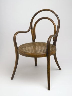 Gebrüder Thonet. <em>Child's Armchair</em>, ca. 1875. Copper beech, modern caning, metal screws, 24 3/4 x 14 x 17 1/4 in. (62.9 x 35.6 x 43.8 cm). Brooklyn Museum, Gift of Dr. Barry R. Harwood, 83.155. Creative Commons-BY (Photo: Brooklyn Museum, 83.155_PS6.jpg)