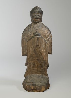 Enku (Japanese, 1628-1695). <em>Yakushi (Bhaishajaguru, The Buddha of Healing)</em>, 17th century. Wood, 17 x 6 1/2 in. (43.2 x 16.5 cm). Brooklyn Museum, Gift of Allen Hubbard and Susan Dickes Hubbard, 83.167. Creative Commons-BY (Photo: Brooklyn Museum, 83.167_front_PS6.jpg)