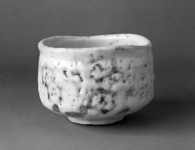 Sasaki Yosoji (Japanese). <em>E-Shino Ware Tea Bowl</em>, ca. 1960. Buff stoneware, 3 3/4 x 5 1/4 in. (9.5 x 13.3 cm). Brooklyn Museum, Gift of Mr. and Mrs. Richard Sneider, 83.173.4. Creative Commons-BY (Photo: Brooklyn Museum, 83.173.4_bw.jpg)