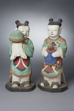 <em>Boy Attendants (Dong-ja), Pair of Figures</em>, 18th century. Polychromed wood, 83.174.1: 19 7/8 x 9 1/2 x 8 1/2 in. (50.5 x 24.1 x 21.6 cm). Brooklyn Museum, Gift of Dr. and Mrs. Stanley L. Wallace, 83.174.1-.2. Creative Commons-BY (Photo: Brooklyn Museum, 83.174.1-.2_PS11.jpg)