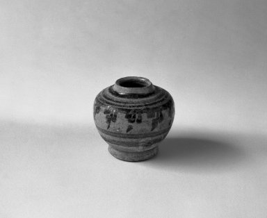 <em>Sawankhalok Miniature Jar, 2 of 5</em>, 14th century. Buff stoneware, H: 1 5/8 in. (4.1 cm). Brooklyn Museum, Gift of Dr. Joel Canter, 83.181.4. Creative Commons-BY (Photo: Brooklyn Museum, 83.181.4_bw.jpg)