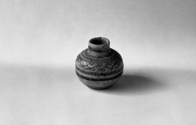 <em>Sawankhalok Miniature Jar, 3 of 5</em>, 14th century. Buff stoneware, H: 1 1/2 in. (3.8 cm). Brooklyn Museum, Gift of Dr. Joel Canter, 83.181.5. Creative Commons-BY (Photo: Brooklyn Museum, 83.181.5_bw.jpg)