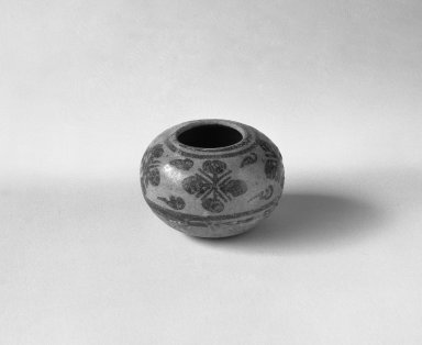 <em>Sawankhalok Miniature Jar, 4 of 5</em>, 14th century. Buff stoneware, H: 1 1/4 in. (3.2 cm). Brooklyn Museum, Gift of Dr. Joel Canter, 83.181.6. Creative Commons-BY (Photo: Brooklyn Museum, 83.181.6_bw.jpg)