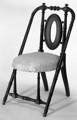 George Jacob Hunzinger (American, born Germany, 1835-1898). <em>Armchair</em>, ca. 1869. Walnut, 33 1/4 x 18 3/4 x 20 3/8 in. (84.5 x 47.6 x 51.8 cm). Brooklyn Museum, Gift of James Pilgrim, 83.226. Creative Commons-BY (Photo: Brooklyn Museum, 83.226_bw_IMLS.jpg)