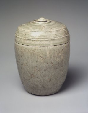 <em>Jar with Lid</em>, 9th century. Straw-glazed stoneware, 6 1/4 x 4 3/4 in. (15.9 x 12.1 cm). Brooklyn Museum, Gift of Dr. Fred S. Hurst, 83.235.3. Creative Commons-BY (Photo: Brooklyn Museum, 83.235.3_transp6295.jpg)