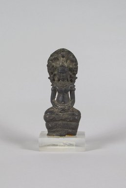 <em>Buddha Sheltered by Mucalinda</em>, 12th-13th century. Bronze, 4 1/2 x 1 7/8 in. (11.4 x 4.8 cm). Brooklyn Museum, Gift of Dr. Malcolm Idelson, 83.237.4. Creative Commons-BY (Photo: Brooklyn Museum, 83.237.4_PS5.jpg)