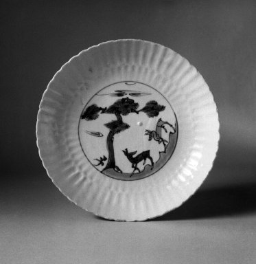 <em>Plate</em>, 1621-1627. Porcelain with underglaze, 1 3/8 x 7 15/16 in. (3.5 x 20.1 cm). Brooklyn Museum, Gift of Dr. Ralph C. Marcove, 83.243.2. Creative Commons-BY (Photo: Brooklyn Museum, 83.243.2_bw.jpg)