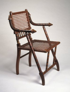George Jacob Hunzinger (American, born Germany, 1835-1898). <em>Armchair</em>, ca. 1876. Walnut, steel mesh, fabric, 33 3/8 x 21 x 18 1/2 in. (84.8 x 53.3 x 47 cm). Brooklyn Museum, H. Randolph Lever Fund, 83.27. Creative Commons-BY (Photo: Brooklyn Museum, 83.27_IMLS_SL2.jpg)