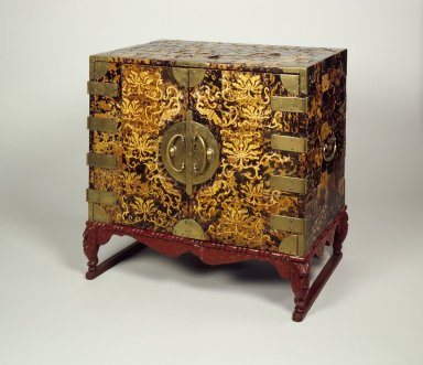 <em>Cabinet with Drawers</em>, early 20th century. Wood, tortoise shell, brass, red lacquer base, 24 1/8 x 25 3/16 x 15 11/16 in. (61.2 x 64 x 39.8 cm). Brooklyn Museum, Gift of Mrs. William R. Maris, 83.62.1. Creative Commons-BY (Photo: Brooklyn Museum, 83.62.1_closed.jpg)