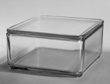 Wilhelm Wagenfeld (1900-1990). <em>Rectangular Container with Lid, from 10-Piece Set of Kitchen Storage Glassware, Kubus</em>, ca. 1938. Clear glass, overall height: 3 5/8 in. (9.2 cm). Brooklyn Museum, Gift of Barry Friedman, 84.121.4a-b. Creative Commons-BY (Photo: Brooklyn Museum, 84.121.4a-b_bw.jpg)