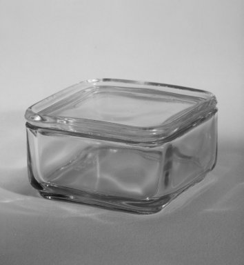 Wilhelm Wagenfeld (1900-1990). <em>Square Container with Lid, from 10-Piece Set of Kitchen Storage Glassware, Kubus</em>, 1938. Clear glass, overall height: 2 in. (5.0 cm). Brooklyn Museum, Gift of Barry Friedman, 84.121.9a-b. Creative Commons-BY (Photo: Brooklyn Museum, 84.121.9a-b_bw.jpg)