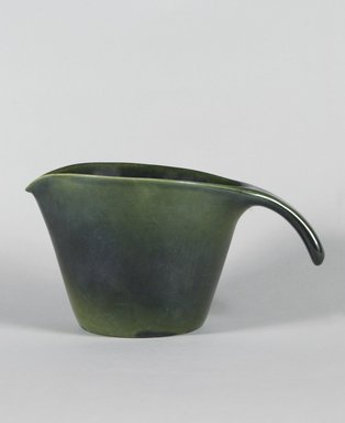 Mary Wright. <em>Pitcher</em>, ca. 1940. Earthenware with green glaze, 5 1/2 x 10 x 6 1/4 in. (14 x 25.4 x 15.9 cm). Brooklyn Museum, Gift of Paul F. Walter, 84.124.2. Creative Commons-BY (Photo: Brooklyn Museum, 84.124.2_PS5.jpg)
