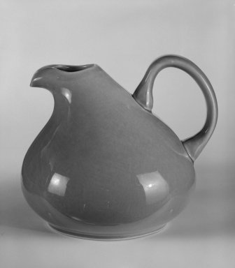 "Russel Wright (American, 1904-1976). <em>Pitcher ""American Modern"" Pattern</em>, ca. 1937. Earthenware with coral glaze, 6 3/8 x 6 1/4 x 7 1/2 in. (16.2 x 15.9 x 19.1 cm). Brooklyn Museum, Gift of Paul F. Walter, 84.124.3. Creative Commons-BY (Photo: Brooklyn Museum, 84.124.3_bw.jpg)"