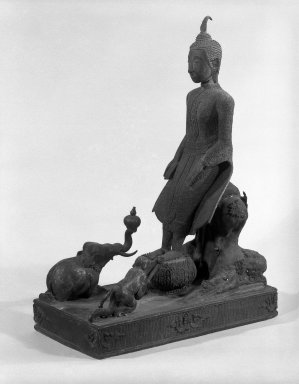 <em>Buddha Venerated by the Animal Kingdom</em>, 18th-19th century. Bronze, 15 x 5 1/2 in. (38.1 x 14 cm). Brooklyn Museum, Gift of Dr. Andrew Dahl, 84.133.4. Creative Commons-BY (Photo: Brooklyn Museum, 84.133.4_bw.jpg)
