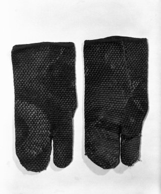 <em>Pair of Fireman's Gloves</em>, 19th century. Indigo-dyed cotton cloth, 9 3/4 x 5 in. (24.8 x 12.7 cm). Brooklyn Museum, Gift of Dr. John P. Lyden, 84.139.8a-b (Photo: Brooklyn Museum, 84.139.8a-b_bw.jpg)
