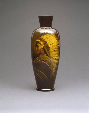 Grace Young (American, 1869-1947). <em>Vase, Chief Shavehead</em>, ca. 1899. Glazed earthenware, 15 1/2 x 6 x 6 in.  (39.4 x 15.2 x 15.2 cm). Brooklyn Museum, Gift of Mr. and Mrs. Jay Lewis, 84.176.4. Creative Commons-BY (Photo: Brooklyn Museum, 84.176.4_SL1.jpg)
