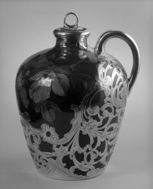 Rookwood Pottery Company (1880-1967). <em>Whiskey Jug with Lid</em>, ca. 1891. Glazed white clay with silver overly, 8 x 6 1/2 x 6 in. (20.3 x 16.5 x 15.2 cm). Brooklyn Museum, Gift of Mr. and Mrs. Jay Lewis, 84.176.5a-b. Creative Commons-BY (Photo: Brooklyn Museum, 84.176.5a-b_bw.jpg)