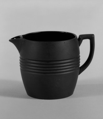 Keith Murray (English, born New Zealand, 1892-1981). <em>Creamer</em>, 1931-1938. Basalt ware, 2 3/4 x 3 3/4 x 2 1/2 in. (7 x 9.5 x 6.4 cm). Brooklyn Museum, Gift of Paul F. Walter, 84.178.2. Creative Commons-BY (Photo: Brooklyn Museum, 84.178.2_bw.jpg)
