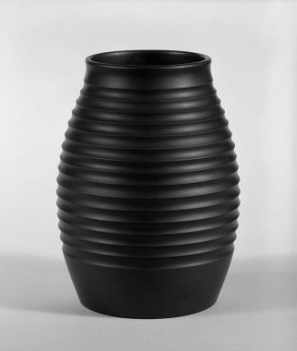 Keith Murray (English, born New Zealand, 1892-1981). <em>Vase</em>, ca. 1933-1936. Basalt ware, 5 1/2 x 3 in. (14 x 7.6 cm). Brooklyn Museum, Gift of Paul F. Walter, 84.178.4. Creative Commons-BY (Photo: Brooklyn Museum, 84.178.4_bw.jpg)