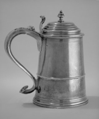 John Burt (1693-1746). <em>Tankard</em>, ca. 1730. Silver, 8 1/2 x 7 1/8 x 5 1/16 in.  (21.6 x 18.1 x 12.9 cm). Brooklyn Museum, Gift of Wunsch Foundation, Inc., 84.179.1. Creative Commons-BY (Photo: Brooklyn Museum, 84.179.1_view1_bw.jpg)