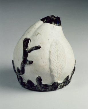 <em>Water Dropper in the Shape of a Peach</em>, 19th century. White Porcelain with iron oxide brown-black pigment under a clear glaze, 5 1/8 in. (13 cm). Brooklyn Museum, Gift of Dr. and Mrs. John P. Lyden, 84.196.5. Creative Commons-BY (Photo: Brooklyn Museum, 84.196.5.jpg)