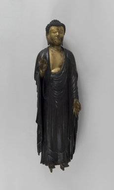 <em>Amida Nyorai (Amitabha Buddha)</em>, 19th century or earlier. Gilt and lacquered wood, 30 1/2 x 9 1/4 in. (77.5 x 23.5 cm). Brooklyn Museum, Gift of Edna Severin, 84.204. Creative Commons-BY (Photo: Brooklyn Museum, 84.204_PS5.jpg)