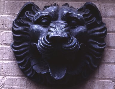William Welles Bosworth (American, 1868-1966). <em>Lion's Head Ornament, from A.T. & T. Building, 195 Broadway, NYC</em>, ca. 1913. Bronze, 14 x 15 x 9 in. (35.6 x 38.1 x 22.9 cm). Brooklyn Museum, Gift of Stanley Smith, President, A.T. & T. Resource Management, 84.215. Creative Commons-BY (Photo: F Stop Fitzgerald, 84.215_view1.jpg)