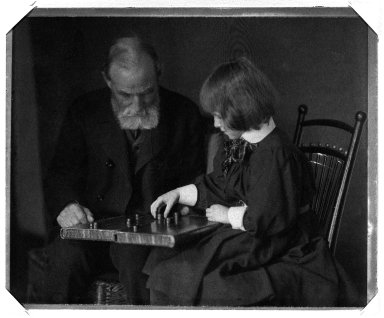 Gertrude Kasebier (American, 1852-1934). <em>[Untitled] (Seated Portrait of William Rand and Grandaughter Peggy Lee Playing Checkers)</em>, ca. 1898-1900. Platinum print, image: 4 15/16 x 6 1/8 in. (12.5 x 15.5 cm). Brooklyn Museum, Gift of Mr. and Mrs. Miguel LaSalle and Peter Sinclair, 84.22.3 (Photo: Brooklyn Museum, 84.22.3_bw.jpg)