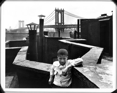 "Walter Rosenblum (American, 1919-2006). <em>""Boy on Roof"" Monroe Street, New York</em>, 1950. Gelatin silver photograph, sheet: 11 × 14 in. (27.9 × 35.6 cm). Brooklyn Museum, Gift of Lisa Rosenblum, 84.236.9. © artist or artist's estate (Photo: Brooklyn Museum, 84.236.9_bw.jpg)"