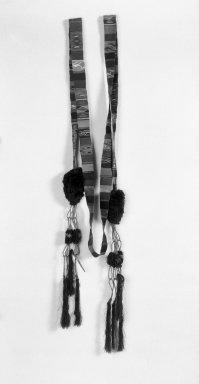 <em>Woman's Cinto (Hair Ribbon)</em>, 20th century. Cotton, silk, metallic threads, unid.plant fiber, 2 1/2 (width of black pompom) x 143 in. (6.4 x 363.2 cm). Brooklyn Museum, Gift of Mary Sefton Thomas, 84.284. Creative Commons-BY (Photo: Brooklyn Museum, 84.284_bw.jpg)