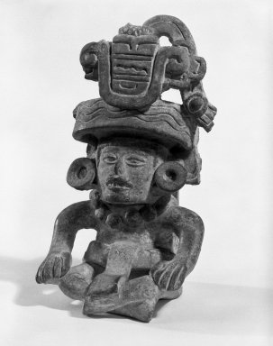 Zapotec. <em>Urn</em>, 200-300 C.E. Ceramic, 7 × 4 in. (17.8 × 10.2 cm). Brooklyn Museum, Gift of Frederic Zeller, 84.285.2. Creative Commons-BY (Photo: Brooklyn Museum, 84.285.2_bw.jpg)