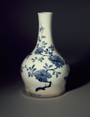 <em>Bottle</em>, early 20th century. Porcelain with underglaze cobalt decoration, Height: 10 3/16 in. (25.8 cm). Brooklyn Museum, Purchased with funds given by Stanley Herzman, 84.37. Creative Commons-BY (Photo: Brooklyn Museum, 84.37.jpg)