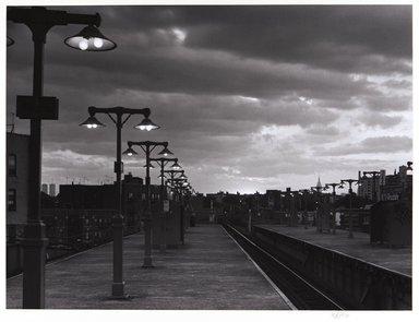 Irwin Silver (American, born 1945). <em>El Station at Dusk, Woodside, New York, Septemberr, 1980, 6:45 P.M.</em>. Gelatin silver photograph, image: 9 3/4 × 13 1/16 in. (24.8 × 33.1 cm). Brooklyn Museum, Gift of the artist, 84.44.10. © artist or artist's estate (Photo: , 84.44.10_PS11.jpg)