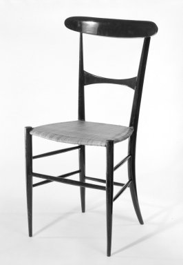 Botti and Gandolfo. <em>Charivari Side Chair</em>, 1950s. Ebonized wood with cane seat, 34 1/8 x 15 1/4 x 14 1/2 in. (86.7 x 38.7 x 36.8 cm). Brooklyn Museum, Gift of Christopher Brent, 84.5.2. Creative Commons-BY (Photo: Brooklyn Museum, 84.5.2_bw.jpg)