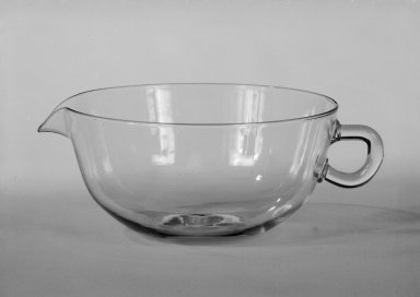 Wilhelm Wagenfeld (1900-1990). <em>Creamer</em>, 1930-1934. Clear heat-resistant glass, 1 3/4 x 5 x 3 7/8 in. (4.4 x 12.7 x 9.8 cm). Brooklyn Museum, Gift of Barry Friedman, 84.64.2. Creative Commons-BY (Photo: Brooklyn Museum, 84.64.2_bw.jpg)