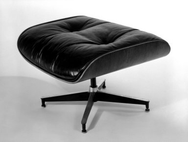 Charles Eames (American, 1907-1978). <em>Ottoman, Model 671</em>, designed 1956; manufactured mid-1960s. Molded rosewood plywood, leather, 16 3/4 x 25 1/2 x 22 in. (42.5 x 64.8 x 55.9 cm). Brooklyn Museum, Gift of Alice Topp Lee in memory of David Conant Ford, 84.65.2. Creative Commons-BY (Photo: Brooklyn Museum, 84.65.2_bw.jpg)