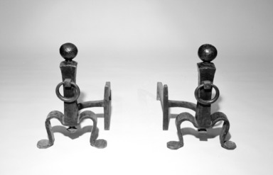 Gustav Stickley (1857-1942). <em>Pair of Andirons</em>, ca. 1905. Wrought iron, Other: 19 3/8 x 12 1/2 x 22 7/8 in. (49.2 x 31.8 x 58.1 cm). Brooklyn Museum, Gift of Edgar O. Smith, 85.108a-b. Creative Commons-BY (Photo: Brooklyn Museum, 85.108a-b_bw.jpg)