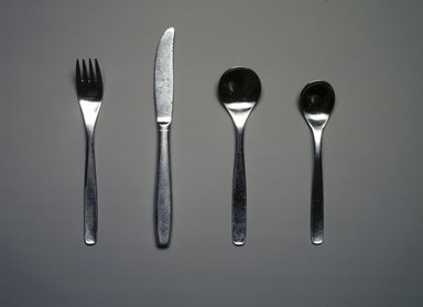 Russel Wright (American, 1904-1976). <em>Four-Piece Flatware Setting</em>, ca. 1950-1958. Stainless steel, Fork (a): 1 1/8 x 1 x 7 3/16 in. (2.9 x 2.5 x 18.3 cm). Brooklyn Museum, Gift of Paul F. Walter, 85.109.1a-d. Creative Commons-BY (Photo: Brooklyn Museum, 85.109.1a-d_transp5218.jpg)