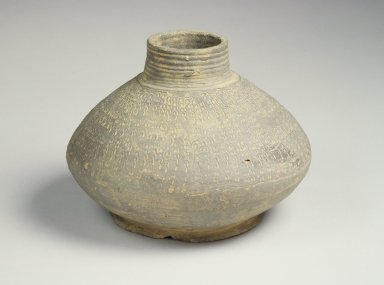 <em>Jar with Stamped Decorations, Inhwa Pattern</em>, 7th-8th century. Gray Stoneware, Height: 4 13/16 in. (12.2 cm). Brooklyn Museum, Gift of Mr. and Mrs. Roger Elliot and Mr. and Mrs. Jack Ford in memory of Jean Alexander, 85.114.3. Creative Commons-BY (Photo: Brooklyn Museum, 85.114.3.jpg)